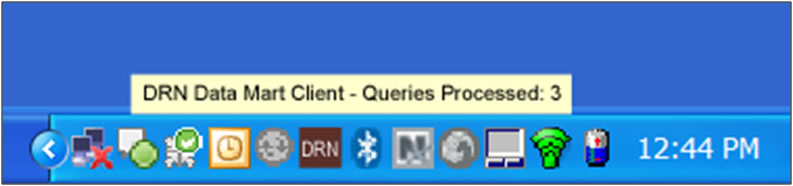 This screen shot shows the Data Mart Client tray icon. Messages appear when the Client receives and processes queries while set in unattended mode.
